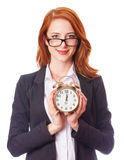 Redhead girl with clock Royalty Free Stock Photo
