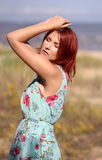 Redhead girl with closed eyes enjoying summer sunlight Stock Photography