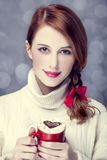 Redhead girl with coffe. Stock Images
