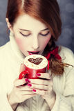 Redhead girl with coffe. Stock Photo