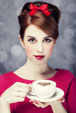 Redhead girl with coffee cup. St. Valentine Day. Royalty Free Stock Images