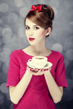 Redhead girl with coffee cup. St. Valentine Day. Stock Images