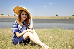 Redhead girl at countryside nead lake. Stock Photos