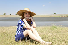 Redhead girl at countryside nead lake. Royalty Free Stock Images