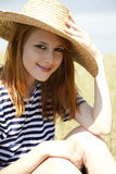 Redhead girl at countryside nead lake. Royalty Free Stock Photos