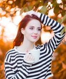 Girl with cup of coffee at autumn time Stock Photography