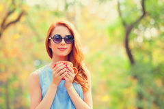 Redhead girl with cup Royalty Free Stock Image