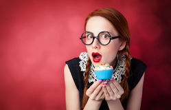Redhead girl with cupcake Royalty Free Stock Photography
