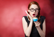 Redhead girl with cupcake Royalty Free Stock Images