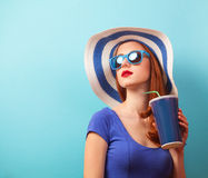 Redhead girl with drink Stock Image