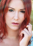 Redhead girl enjoying summer sunlight and calm win Royalty Free Stock Images