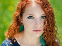 Redhead girl face closeup. Royalty Free Stock Image