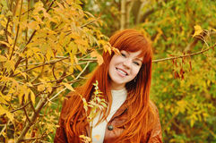 Redhead girl in fall Stock Photography