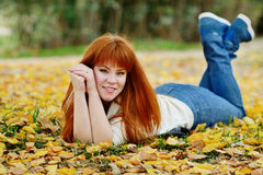 Redhead girl in fall Royalty Free Stock Photo
