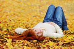 Redhead girl   on the fall meadow Stock Photos