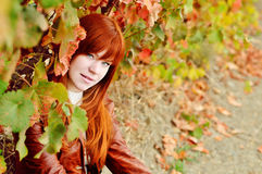 Redhead girl in fall time Stock Photography