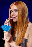 Redhead girl with fantasy drink Royalty Free Stock Photos