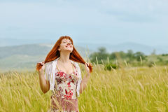 Redhead girl in field Royalty Free Stock Photo