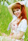Redhead girl in field Stock Photo