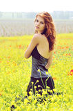Redhead girl in field -  vintage style Stock Image