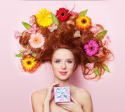 Redhead girl with flowers Royalty Free Stock Photos