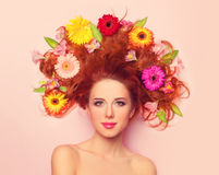 Redhead girl with flowers Stock Image