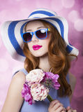 Redhead girl with flowers Stock Images