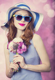 Redhead girl with flowers Royalty Free Stock Image