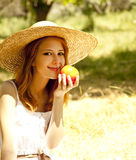 Redhead girl with fruit at garden. Stock Photos