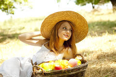 Redhead girl with fruits in basket. Beautiful redhead girl with fruits in basket at garden. Photo #13 Stock Photography