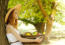 Redhead girl with fruits in basket Royalty Free Stock Image