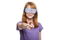 Redhead girl with funny glasses Royalty Free Stock Photo