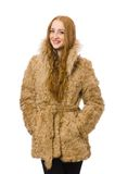 Redhead girl in fur coat isolated on the white Stock Images