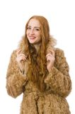 Redhead girl in fur coat isolated on the white Royalty Free Stock Photos