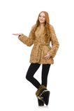 Redhead girl in fur coat isolated on the white Royalty Free Stock Photography