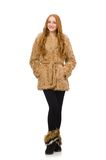 Redhead girl in fur coat isolated on the white Royalty Free Stock Image