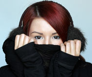 Redhead girl in fur ear muffs Royalty Free Stock Photos