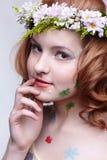 Redhead girl in garland Stock Photos