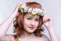 Redhead girl in garland Royalty Free Stock Photos