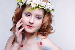 Redhead girl in garland Stock Images