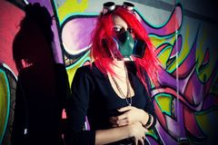 Redhead girl in gasmask Royalty Free Stock Photos