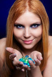 Redhead girl with gel balls Stock Photography