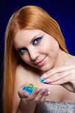 Redhead girl with gel balls Royalty Free Stock Photography