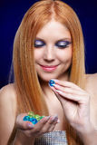 Redhead girl with gel balls Royalty Free Stock Image