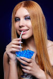 Redhead girl with gel balls Royalty Free Stock Images
