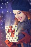 Redhead girl with gift. Royalty Free Stock Image
