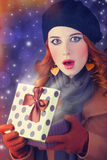 Redhead girl with gift. Royalty Free Stock Photo
