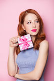 Redhead girl with gift Royalty Free Stock Photography