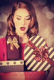 Redhead girl with gift for Valentines Day Royalty Free Stock Photos