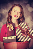 Redhead girl with gift for Valentines Day Stock Photography